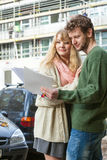 Couple with blueprint project keys on construction site Royalty Free Stock Photography