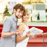 Couple with blueprint project keys outdoor Royalty Free Stock Images