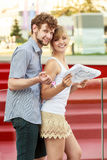 Couple with blueprint project keys outdoor Royalty Free Stock Photography