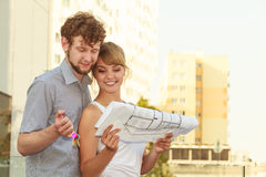 Couple with blueprint project keys outdoor Royalty Free Stock Photos