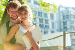 Couple with blueprint project outdoor Royalty Free Stock Photo