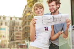 Couple with blueprint project outdoor Stock Photo