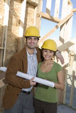 Couple With Blueprint At Site Stock Photography