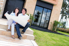 Couple with blueprints Stock Images