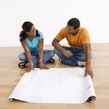 Couple with blueprints. Royalty Free Stock Photos