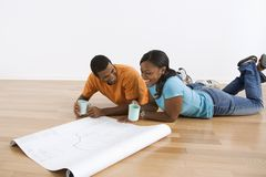Couple with blueprints. Stock Image