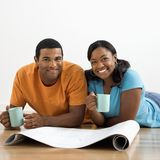 Couple with blueprints. royalty free stock photo