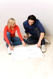 Couple with blueprints Stock Photography