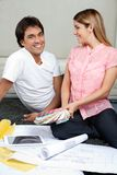Couple With Blueprints And Color Swatches Stock Photography