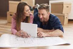 Couple with blueprints house Royalty Free Stock Image