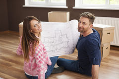 Couple with blueprints house Stock Photography