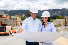 Couple with blueprints of their house Stock Image
