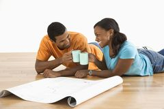 Couple with blueprints toasting. stock images