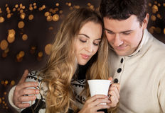 Couple on blurred lights background stock photo
