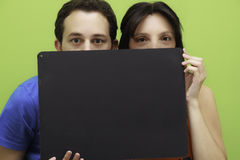 Couple with board Royalty Free Stock Images