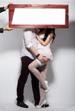 Couple and Board with White Blank Space Royalty Free Stock Images
