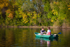 Couple in a boat Stock Images