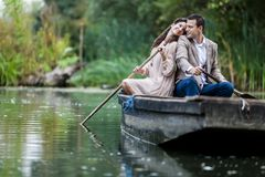 Couple in the boat. Young couple in love in the boat Royalty Free Stock Image