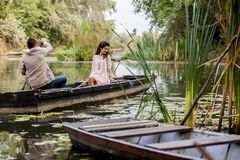 Couple in the boat Stock Images