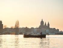 Couple boat Amsterdam Stock Photo