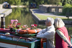 Couple on boat in canal Stock Photography