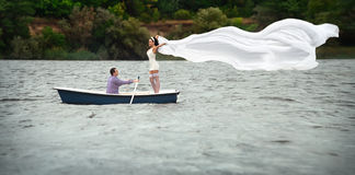 Couple in a boat outdoors Royalty Free Stock Photos