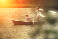Couple in a boat outdoors Royalty Free Stock Photography