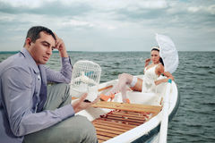 Couple in a boat outdoors Royalty Free Stock Image