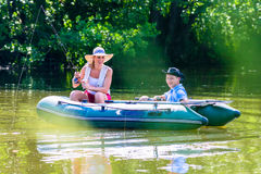 Couple in boat on pond or lake fishing royalty free stock photos