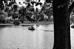 Couple on boat. Couple rowing on boat in Delaware Park, Buffalo (NY Stock Photo