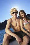 Couple Boating On Lake. Happy young Caucasian couple boating on lake Stock Image