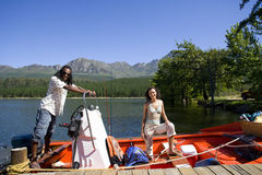 Couple boating on lake Royalty Free Stock Photos