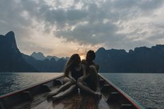 Couple boating on a quiet lake stock images