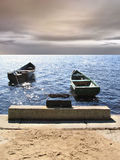 Couple boats. Couple attached boats and cost, sunset royalty free stock images