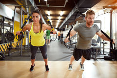 Couple on body training in gym Stock Photography