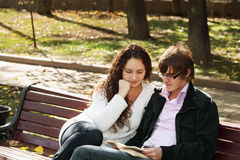 Couple with book Stock Photography