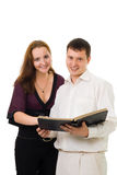 Couple with book  album Stock Image
