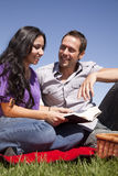 Couple with book happy Stock Image