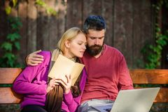 Couple with book and laptop search information. Information source concept. Share or exchange information knowledge. Man. And women use different information royalty free stock photos