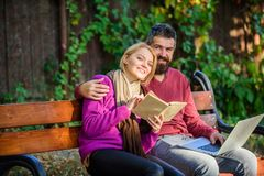 Couple with book and laptop search information. Share or exchange information knowledge. Information source concept. Man. And women use different information royalty free stock image