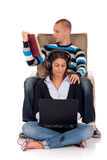 Couple, book laptop sofa Stock Image