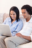 Couple booking holidays online together Royalty Free Stock Photography