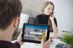 Couple booking hotel room on tablet. Premium apartment reservation concept royalty free stock photography