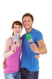 Couple both holding paint brushes Royalty Free Stock Photos