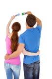 Couple both holding paint brushes Royalty Free Stock Image