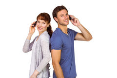 Couple both making phone calls Stock Images