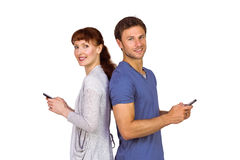 Couple both sending text messages Royalty Free Stock Photo