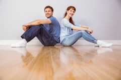 Couple both sitting on floor Stock Images