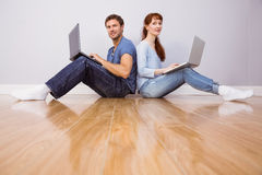 Couple both using laptops separately Stock Image