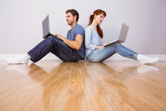 Couple both using laptops separately Royalty Free Stock Photos